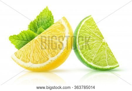 Isolated Two Citrus Fruits Slices. Pieces Of Lemon And Lime With Mint Leaf Isolated On White Backgro
