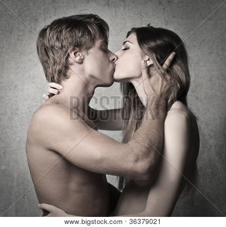 Naked young couple kissing