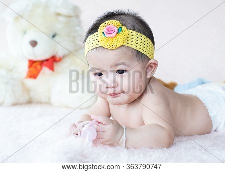 Cute Little Baby Lying Happy Holding Nipple Soother In Hand.newborn On Softness Blanket Holding  Pac