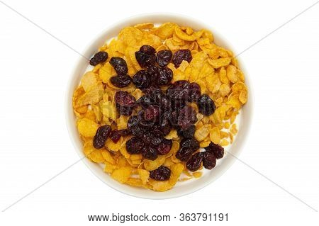 Healthy Breakfast. Milk, Cornflakes And Dried Cranberries In Bowl Isolated On White Background