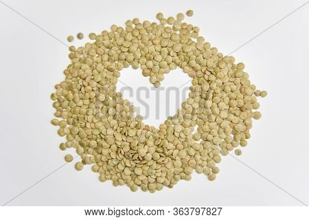 The Heart Shape Assembled With Grains Of Lentil On The White Background. Selective Focus. Healthy Ea