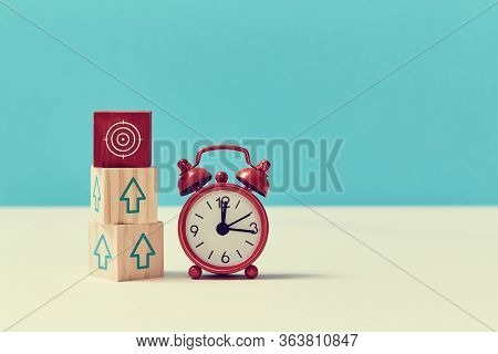 Growth, Fall Time. Time Is Money. Lack Of Time. Time-limit. Business Deadline. Stack Of Wooden Cubes