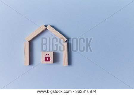 Online Security System. Home Security. Smart House. Alarm System. Wooden House With Cube And Red Pad