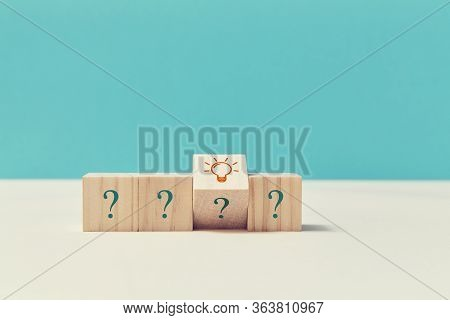 Questions And Answers. Creative Idea. Think Different. Innovation. Wooden Cubes With Question Marks,