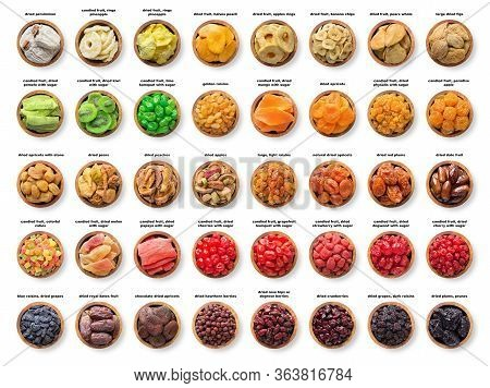 Large Assortment Dried Fruit, Top View. Candied And Sundried Berries In Wooden Bowls Isolated On Whi