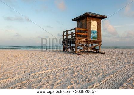 South Florida Lifeguard Shack On Empty Beach In Golden Hour Light