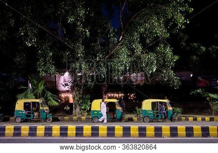 New Delhi / India - September 16, 2019: Tuk Tuks Parked In The Street In New Delhi, India, At Night