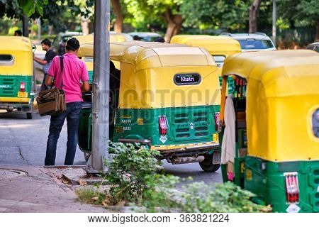 New Delhi / India - September 19, 2019: Man Paying The Fare To The Tuk Tuk Driver In The Street In N