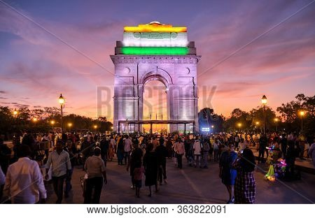 Delhi / India - September 26, 2019: Tourists Visit The Illuminated India Gate War Memorial During Co