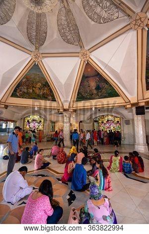Delhi / India - October 2, 2019: People Praying At Iskcon Delhi Hindu Temple Of Lord Krishna, New De