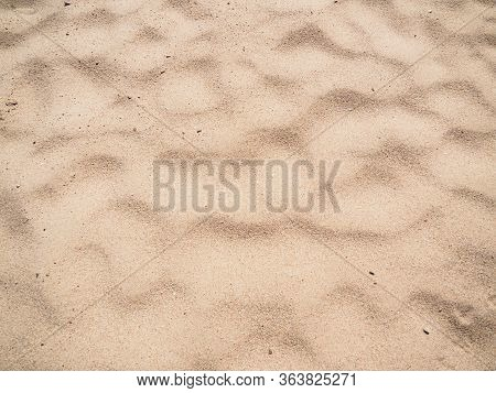 Texture Of Brown Sand, Close Up View. Abstract Pattern On Sand. Egyptian Beach In February, Abstract