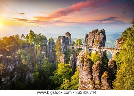 Elbe Sandstone Mountains in the evening light. Location Saxon Switzerland national park, Bastei bridge, East Germany, Europe. Photo of popular tourist attraction. Discover the beauty of earth.
