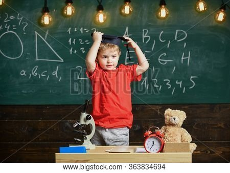 Child, Pupil On Smiling Face Near Microscope. First Former Interested In Studying, Education. Kinder