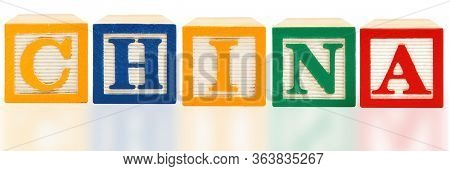 China spelled  in bold color aphabet blocks over white in English
