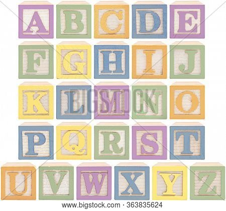 Same view 26 letters of alphabet in wooden blocks in pastel pink, blue, green orange and yellow.