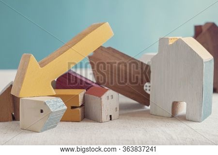 Wooden Houses And Arrow Down, Mortgage Crisis, Property Prices Falling, Financial Meltdown, Economy