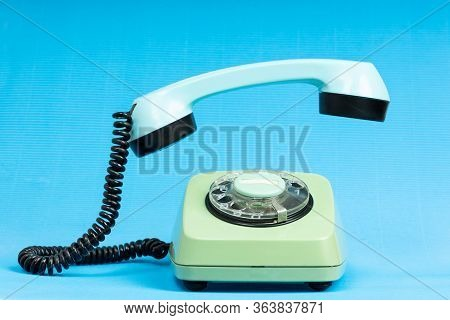 Old Telephone On Blue Background. Vintage Phone With Taken Off Receiver