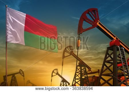 Madagascar Oil Industry Concept, Industrial Illustration. Fluttering Madagascar Flag And Oil Wells O