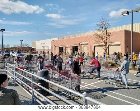 Langley, Canada - April 14, 2020. Shoppers Line Up In A Giant Costco Shopping Cart Maze In Order To