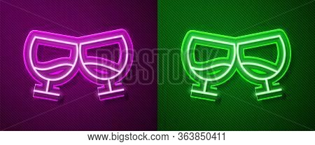 Glowing Neon Line Glass Of Cognac Or Brandy Icon Isolated On Purple And Green Background. Vector Ill
