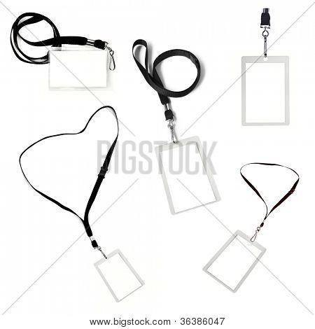 Collection of blank security tags on black lanyards, isolated over white.