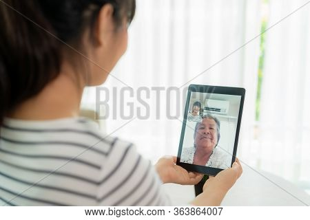 Asian Young Woman Virtual Happy Hour Meeting And Talking Online Together With Her Mother In Video Co