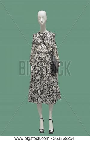 Full Length Female Mannequin Dressed In Fashionable Wear. Isolated On Green Background. No Brand Nam