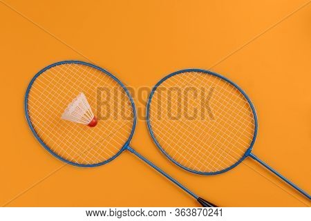 Set Of Shuttlecock And Two Badminton Rackets