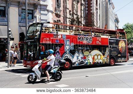 Madrid, Spain - June 1, 2019: Hop-on Hop-off Tour Bus. Madrid City Tour In Gran Via Avenue.