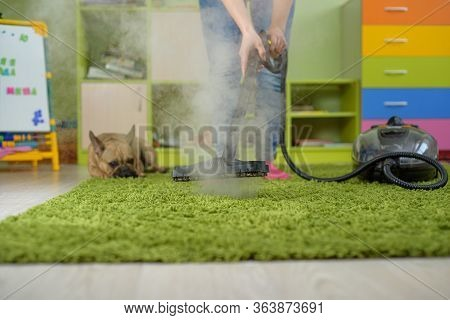 Woman Cleaning Carpet Withsteam Generator In The Children Room. Destroying Allergens - House Dust Mi
