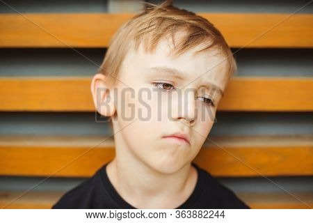 Portrait Of Upset Gloomy Boy. Kid With Pessimistic Depressive Negative Emotions. Boredom Child. Face