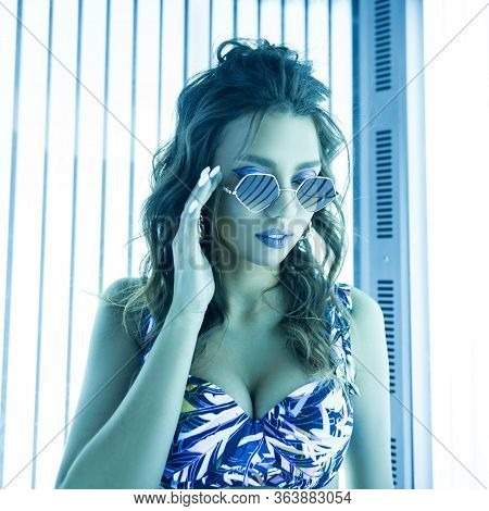 Young Glamorous Woman Model In Fashion Sunglasses With A Trendy Hairstyle In A Stylish Swimsuit Is S