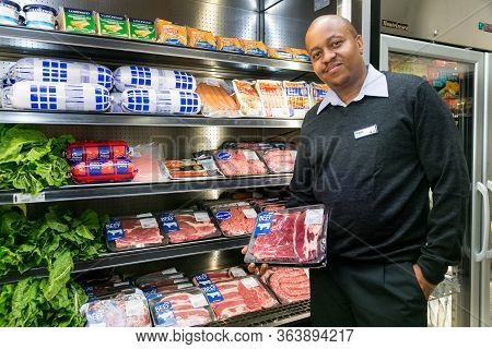 Owner Manager Posing With Produce In Isle At Local Pick N Pay Grocery Store