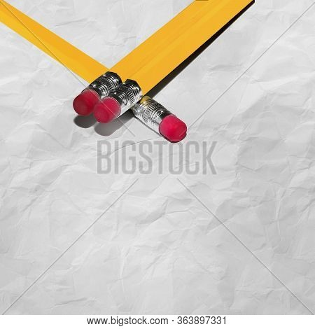 Long Pencils With Eraser On Crumpled Paper With Texture With Copy Space. Stock Image.
