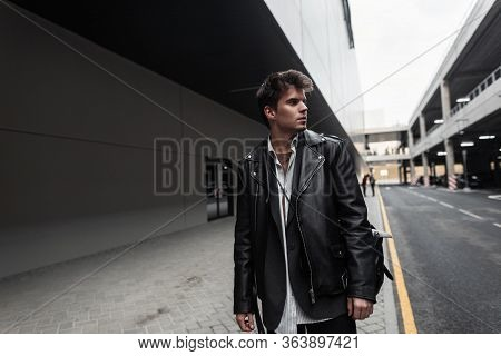 Young Attractive Man Model In An Oversized Stylish Black Leather Jacket In A Shirt In Trousers With