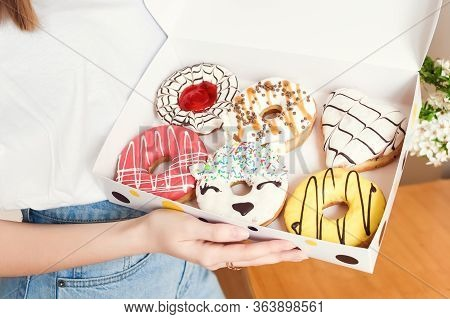 Young Woman Holding Box Of Delicious Donuts. Party Concept. No Diet. Candy Bar. Proper Nutrition Or