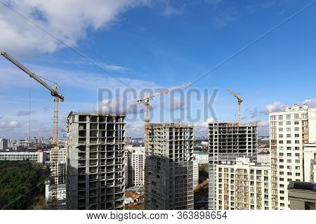 City Panorama, Construction Site With Cranes. Construction Company Guarantees Reliability And Streng