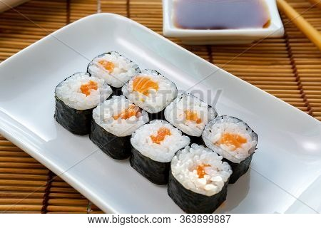 Syake Maki Classic Roll With Fresh Salmon And Wasabi. Hosomaki Thin Rolls, Simple Rolls, Small Rolls