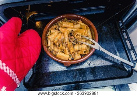 Clay Pot With Hot Rigatoni And Ground Beef Coming Out Of The Oven
