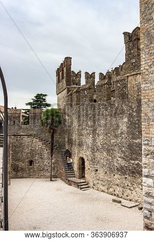 Sirmione, Italy - October 01, 2015 : Tourists Climb The Stairs To The Wall Of The Castello Scaligero