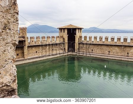 Sirmione, Italy - October 01, 2015 : The Fortified Internal Port Of The Castello Scaligero Fortress