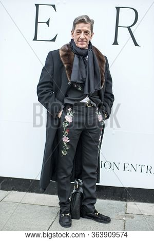 London, Uk- September 13 2019: Maurice Mullen In A Black Wool Coat With A Fur Collar. Black Pants Wi
