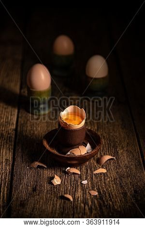 Fresh Brown Eggs On Rustic Table. Broken Egg With Yolk.