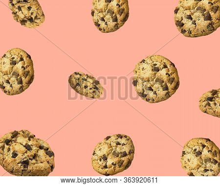 Pattern From Homemade Chocolate Chips Cookies Flying In Air On Pink Background. Baking Kids Birthday