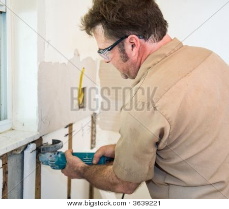 Electrician Using Grinder