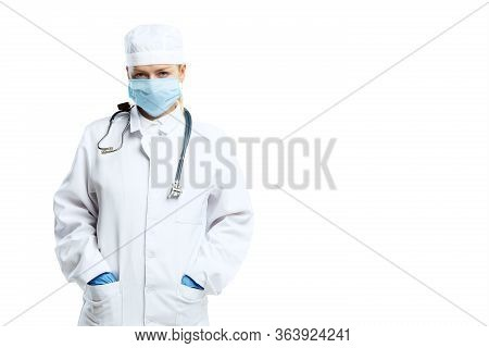 Despair, Depressed. Female Young Doctor With Stethoscope And Face Mask On White Studio Background. L