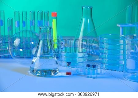 Vaious laboratory glassware with dramatic blue and green light