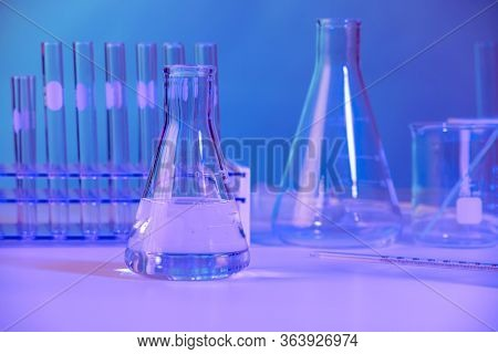 Diverse laboratory glassware with beakes, test tubes and flasks