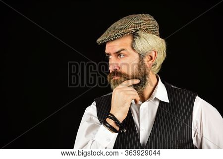 Real Masculinity. Retro Gentlemen. Mature Handsome Man. Masculine Appearance. Bearded Guy On Black B