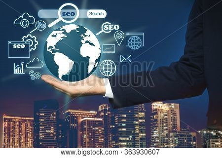 Man Demonstrating Directions Of Seo. World Globe With Icons Of Keyword Research, Customization And O